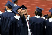 Senior Jeremy Peterson shows his joy after graduating from Loy Norrix High School on June 8th.  One hundred and ninety students walked in the 2011 ceremony