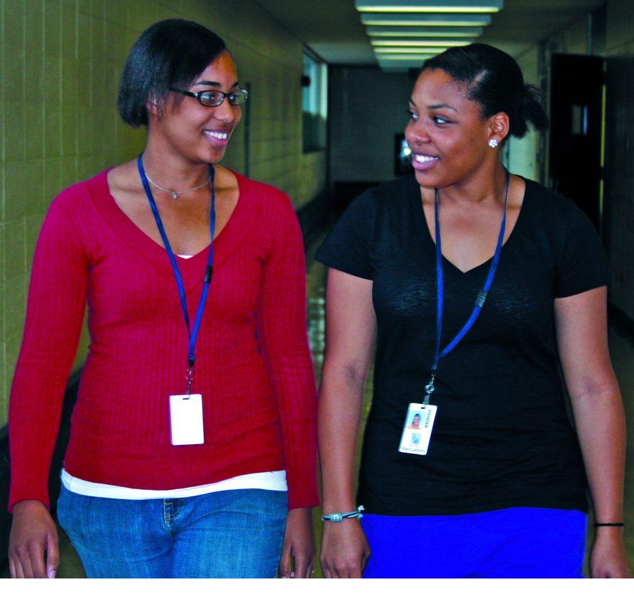 Seniors, Kaila and Karra Larkins walk the hallways of Loy Norrix.