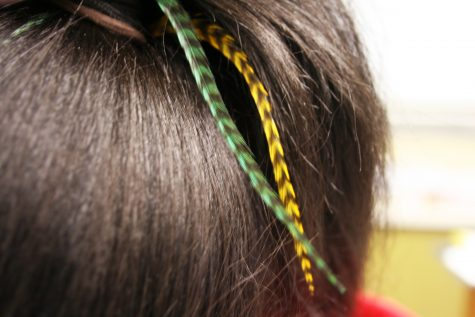 SynQuissa Morris models her feather hair extensions. Morris has had her feathers for about three weeks. Photo by Leah Rathbun