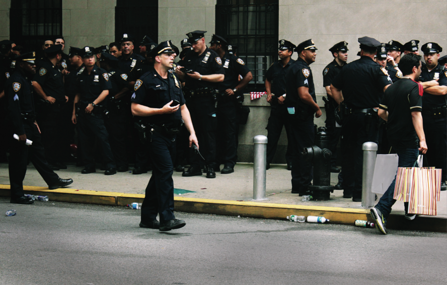 Police staked out on Wall Street. Photo by Ruby Tanja