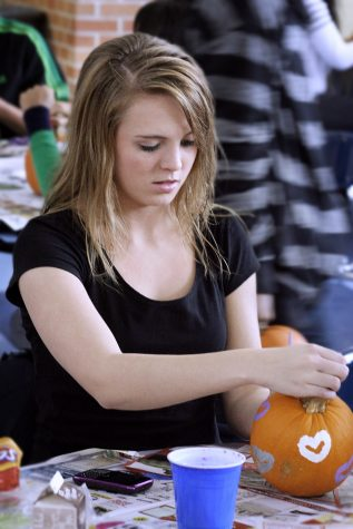 Senior Haley Warner has participated in the Pumpkin Painting Party since her sophomore year. She went because it sounded fun and her friends were going. Photo by Racheal Koole.