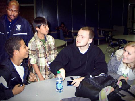 From right to left, EFE/EFA students Alex Bridges, Joey Veeder, Justin Perez, and Brandie Batten wait in the cafeteria before their next class. Although EFE/EFA students do not have anywhere to be once they return from their off site class, due to the heightened security with the tardy procedure, an officer checks in on where they need to be. Photo by Sarah Sherman