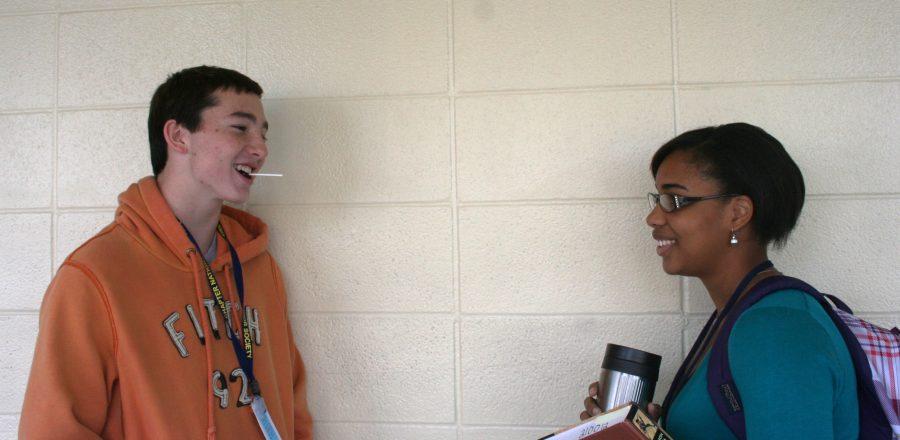 Seniors Kevin Bechtel and Karra Larkins talk between third block as Bechtel eats his lollipop. Photo by Aubrey Butts.
