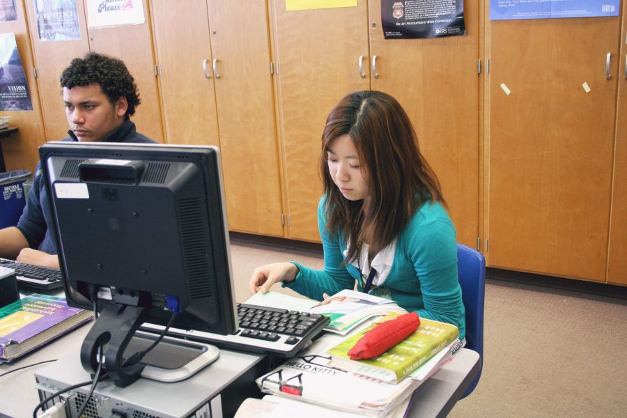 Loy Norrix senior Aya Abe is seen in a Strategic Computer Technology class working on a project. Although not the most engaging class, Abe realizes the importance of attending class for her future plans. Abe plans on either attending Kalamazoo College or Western Michigan University in the Fall. Photo by Leah Rathbun