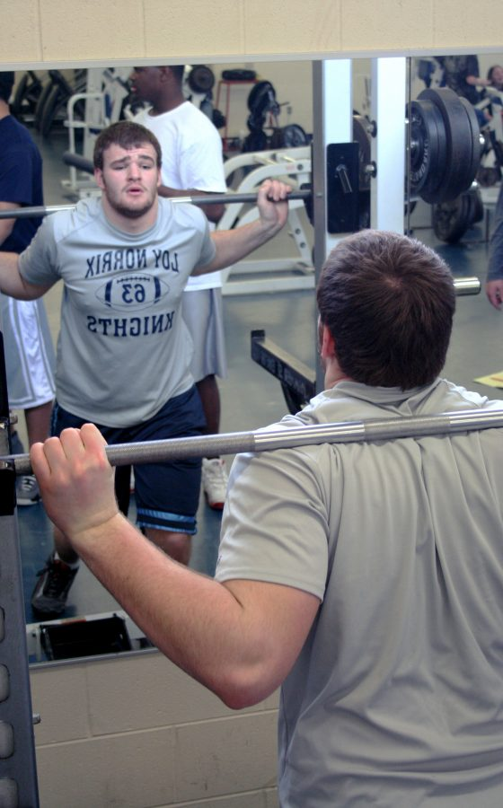 Junior Will Aeschbacher work outs for his last season of high school football. Him and his teammates go to the weight room Monday thru Thursday. By Daniela Paz