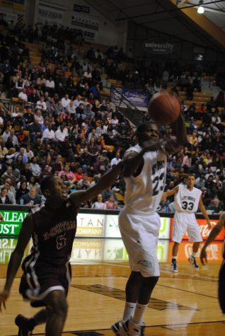 Tony Boykins shoots during a game during the 2011 Boys Basketball Season. Boykins is a forward. He and the rest of the 2012 team hopes to defeat Central this week.