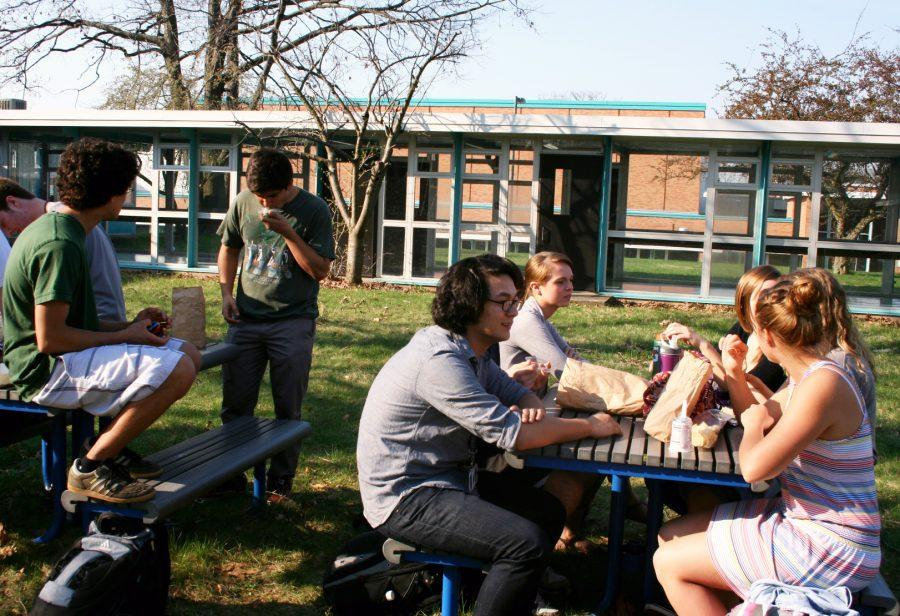 Seniors eat in the senior courtyard during first lunch. The courtyard opened last week due to the warmer weather. Photo by Leah Rathbun.