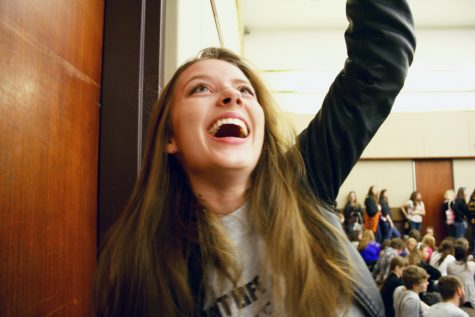 Senior Knight Life reporter, Sarah Sherman cheers as she wins first place in the category of Illustration.  Sarah brought home three state awards on April 17th, making her school and the newspaper staff proud.  Photo by Leah Rathbun