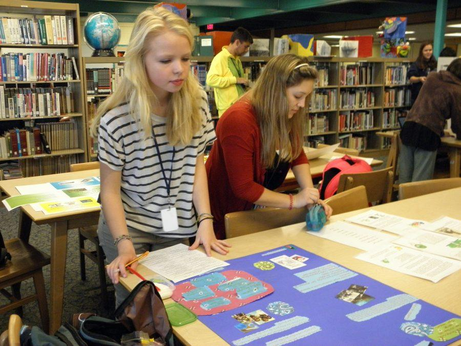 Tatiana Berquist, a sophomore at Loy Norrix, came to Social Studies' teacher, Matthew McCullough's classroom during a fair trade fair. Berquist is a former student of McCullough's. She has also done a fair trade project in global issues. Photo by Matthew McCullough.