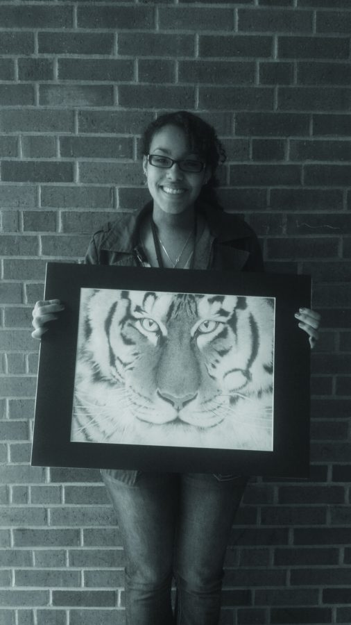 Senior Dendra Stegall has been drawing ever since middle school where she was originally into sculpturing and shifted into drawing. Her amazing drawing of a tiger won Stegall the Gold medal locally.