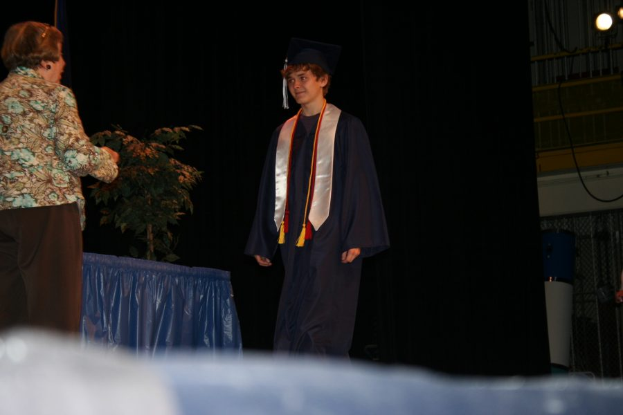 Senior Adam Kemp receives acknowledgement at the Loy Norrix Candlelight ceremony for his Gold Medal on the National Latin Exam.  Twenty-one LN students won this medal.  Three students represented with perfect scores. Photo by Asia Davis