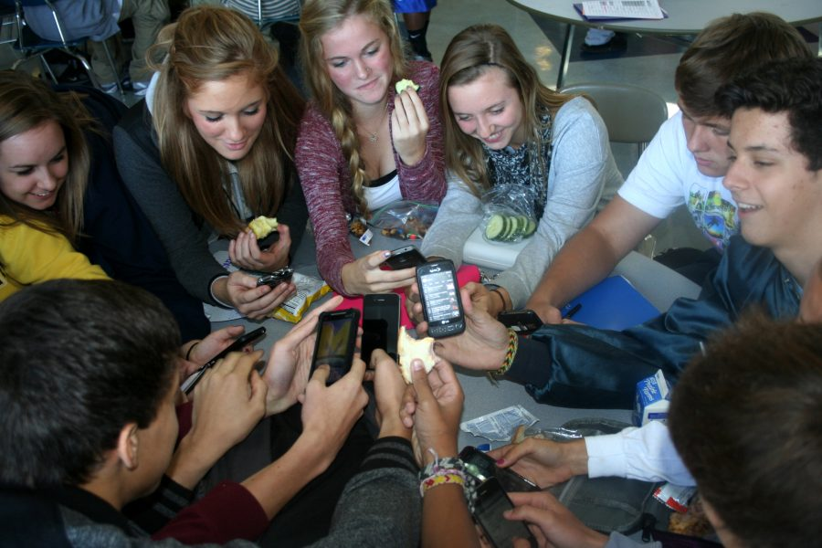 Photo Illustration by Allie Creamer Students are so attached to their cell phones that they are even used at lunch when they should be eating.