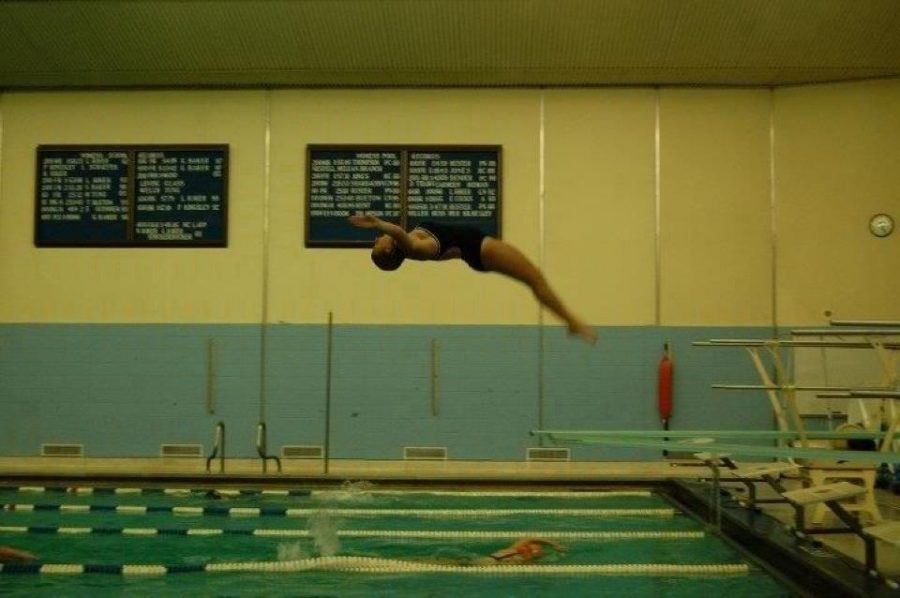 Diver Jena Burkey practices every day at Loy Norrix.  The team hopes to be more united than ever before this year.