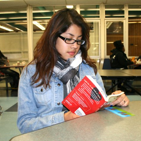 Executive leader of the GSA Cynthia Romero Diaz sits at lunch reading for English. She actively speaks out for the LGBT community in and out of school.
