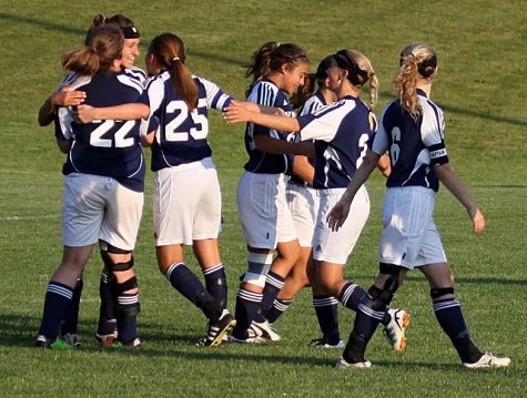 Varsity soccer girls celebrate after a goal was scored against Battle Creek Lakeview. The Lady Knights finished their 2012 season 6-8-2. Photo by Julie DeLuca