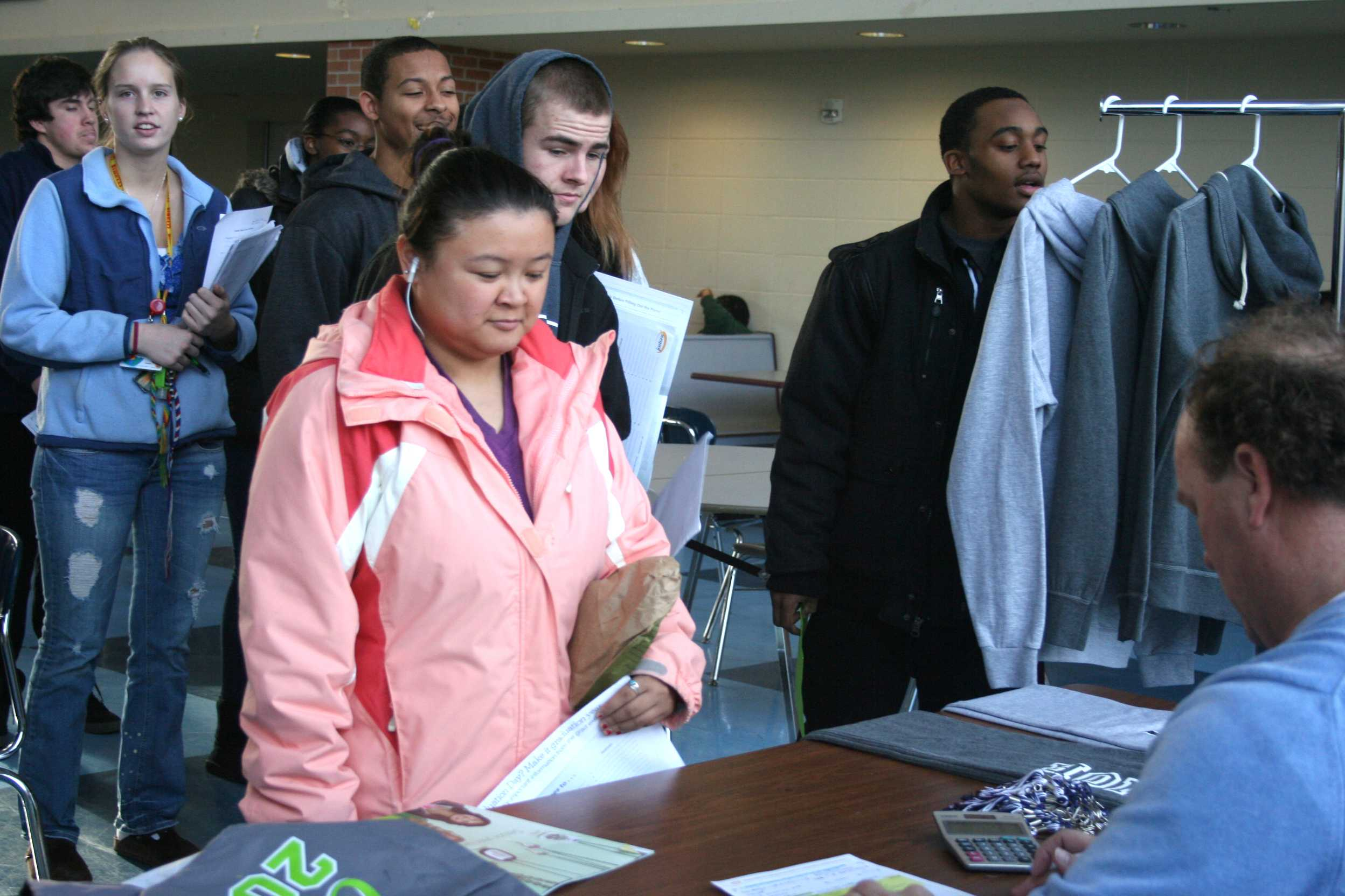 Seniors wait in line to make sure they get one of the most important things needed. The cap and gown that makes graduation official.