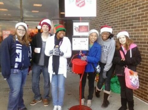 Photo Credit Mary Daly  Peace Jam students ring bells to raise money for the less fortunate. Every year the Salvation Army works together with the community to help out those in need.