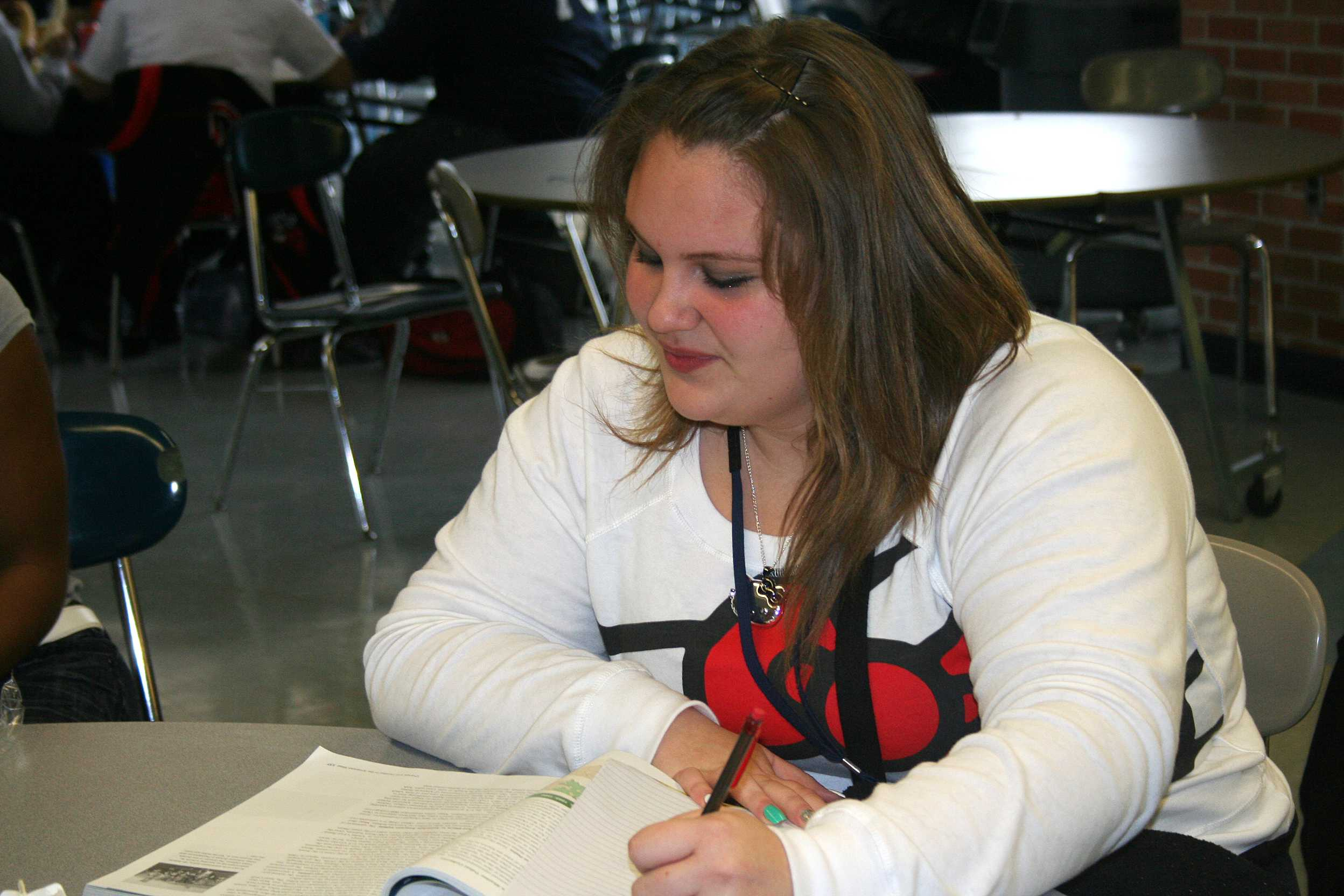 Freshmen Jasmine Brooks works during her lunch. As a freshmen she is worried that she won't get her schoolwork done.