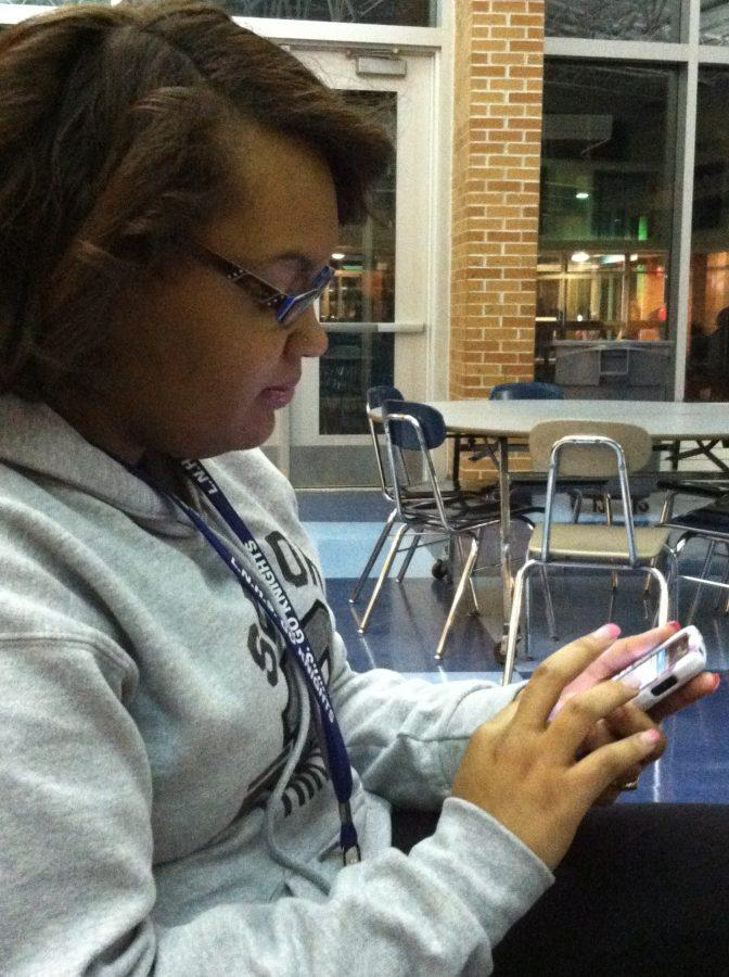Photo by Nikia Jackson Senior Cassie Thompson is checking her Facebook for new updates. Thompson checks all of her social media sites every 30 minutes.