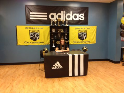 Photo by: Julie Deluca Amelia signed in Grand Rapids along with 36 other crew juniors. She signed with her travel club instead of signing at Loy Norrix.