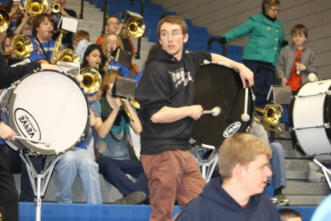 Photo by: Tyler Deau  Ben Schreck plays in the Loy Norrix band at every home basketball game.  The band helps make the games more lively.