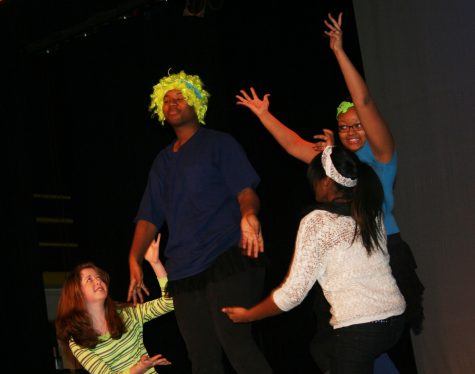 Photo by Marcus Boyd sophomore Melanie Michelle, senior Tyrell Wilks-Williams, senior Raven Vanderbuilt, and sophomore Maryam Muhammad practicing there skit for there drama 2 performance. Tyrell is bring out his inner Nicki Minaj.