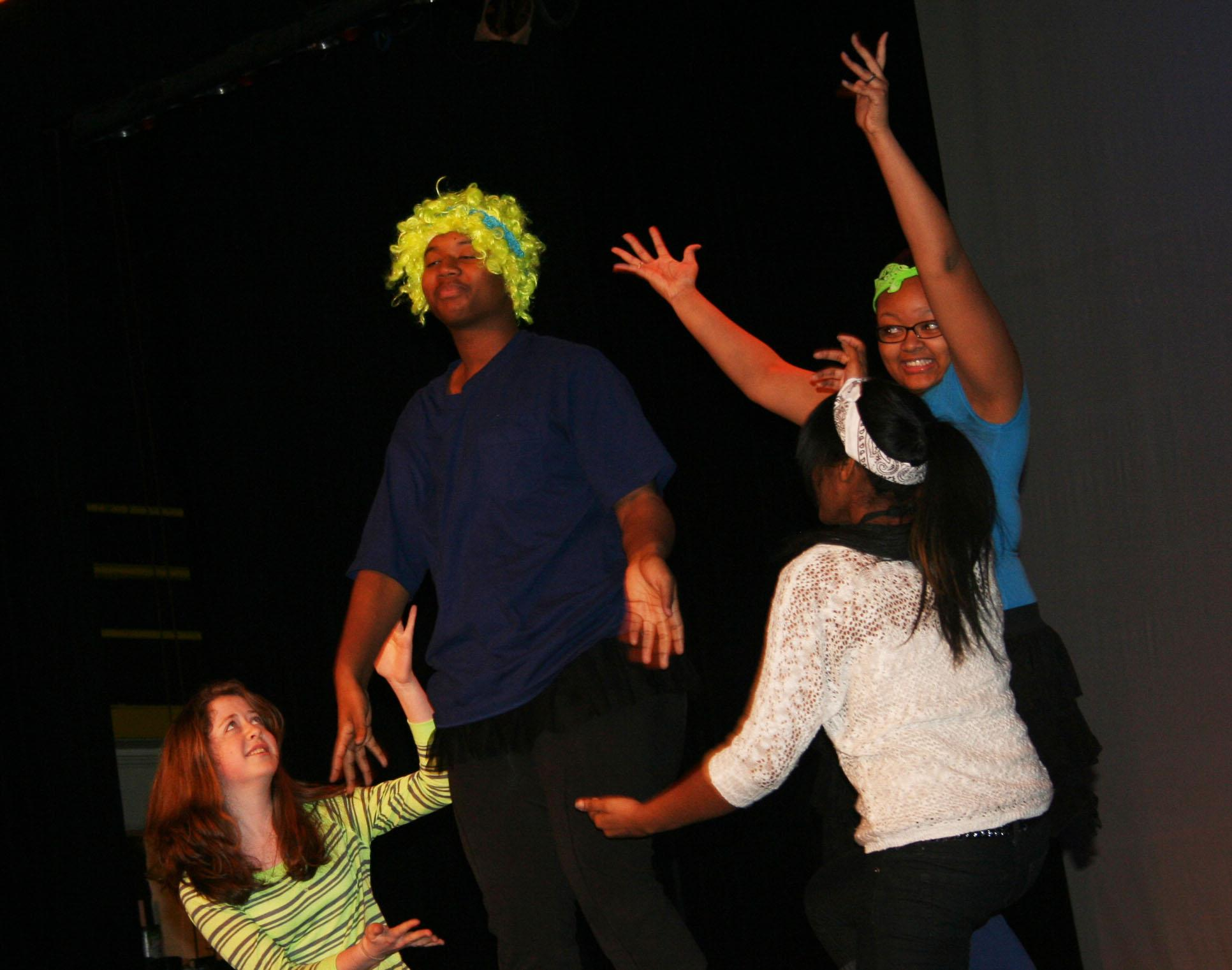 Photo by Marcus Boydsophomore Melanie Michelle, senior Tyrell Wilks-Williams, senior Raven Vanderbuilt, and sophomore Maryam Muhammad practicing there skit for there drama 2 performance. Tyrell is bring out his inner Nicki Minaj.
