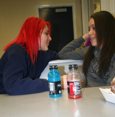 Photo by Mataya Simmons Sophomores Jada Decker and Kasey Perry converse among themselves at lunch. The two students enjoy one anothers company.