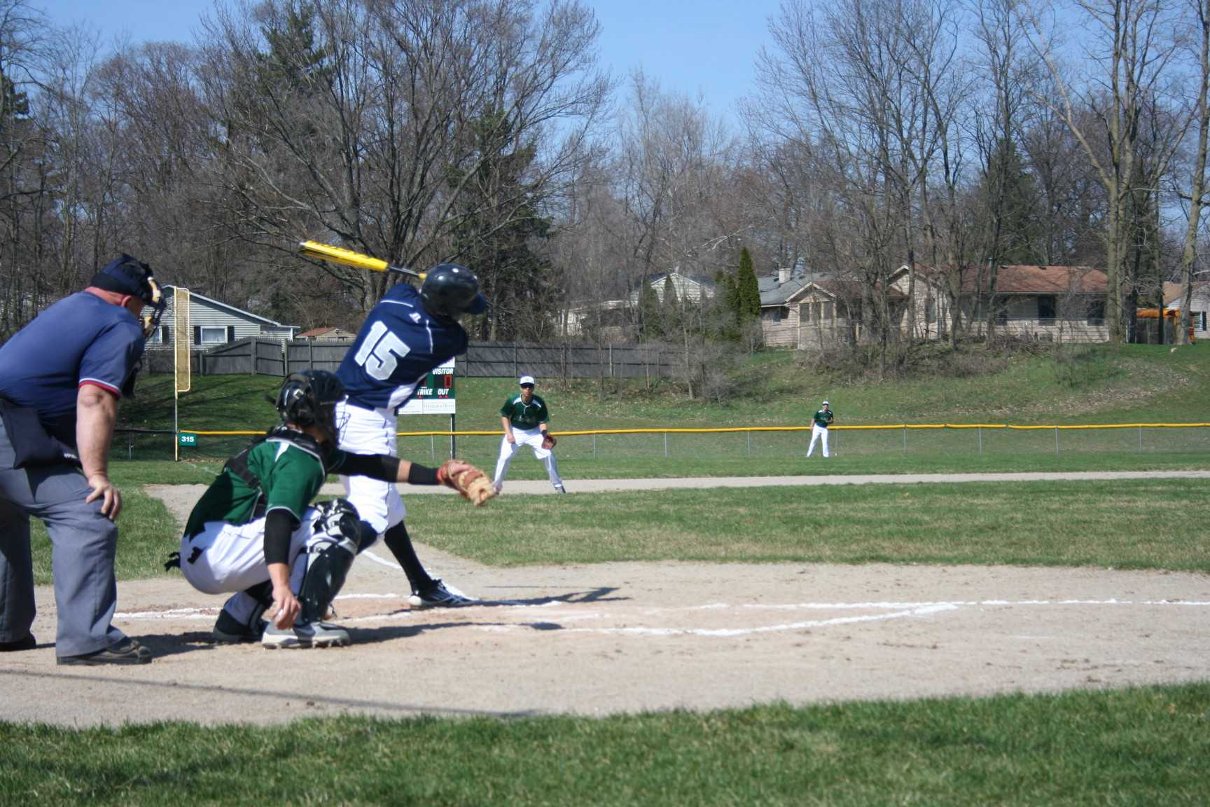 Photo by Mia Leibold Loy Norrix Senior varsity baseball player Thomas Hruska swings the bat at the Norrix varsity game against Hackett on April 22, 2013. Norrix falls with the final score 1-8, Norrix is now 1-2 on the season.