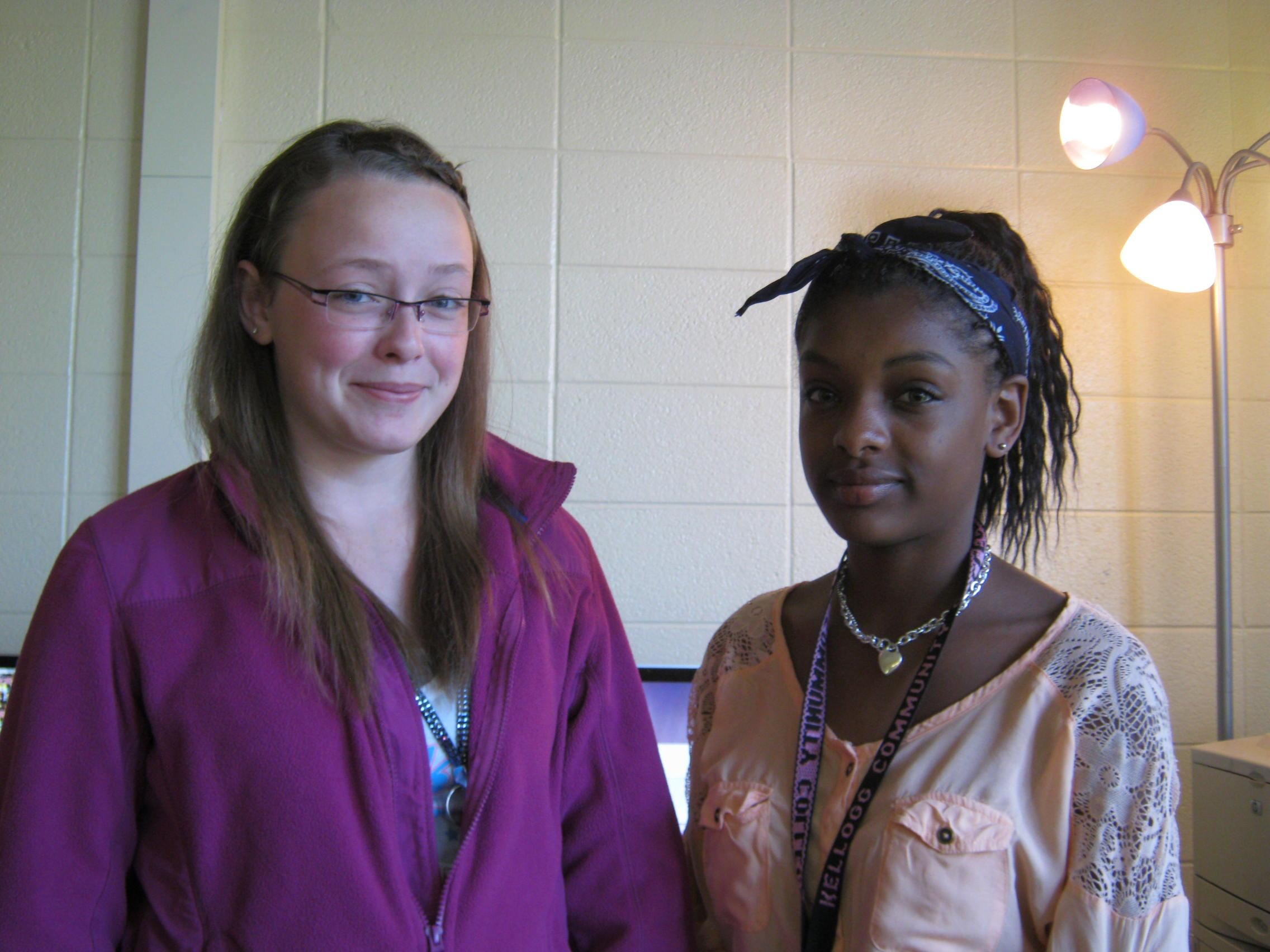 Photo by Corrin Davis After a minute of scuffling to put away their papers, Jillian Kalhorn (left) and Jazmyn Jackson (right) pause in Ms. Pankop's class before heading out to do an out-of-class assignment on May 23rd. For Kalhorn and Jazmyn, the choice to work together on the project was a no-brainer, they didn't even have to discuss it, but were ready to get to work straight after receiving the assignment.