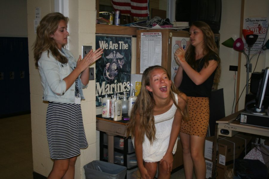 Photo Illustration by Sarah Stevens Sophomores Rachel Wheat Emily Worline and freshman Maddie Olech are putting on lotion at Mr. Williams Lotion Bar. Mango Mandarine is the most common.