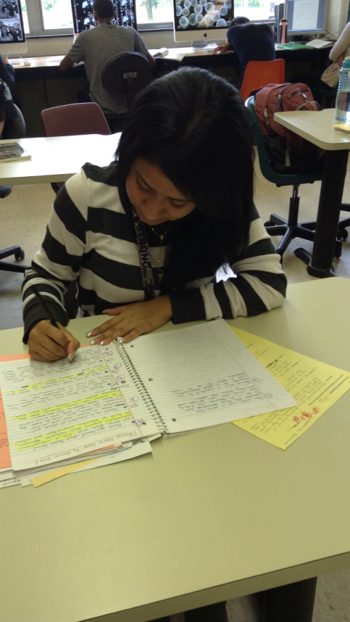 Jasmine Bahena studies her notes for her final exams.  Jasmine graduated from Loy Norrix on June 5th.