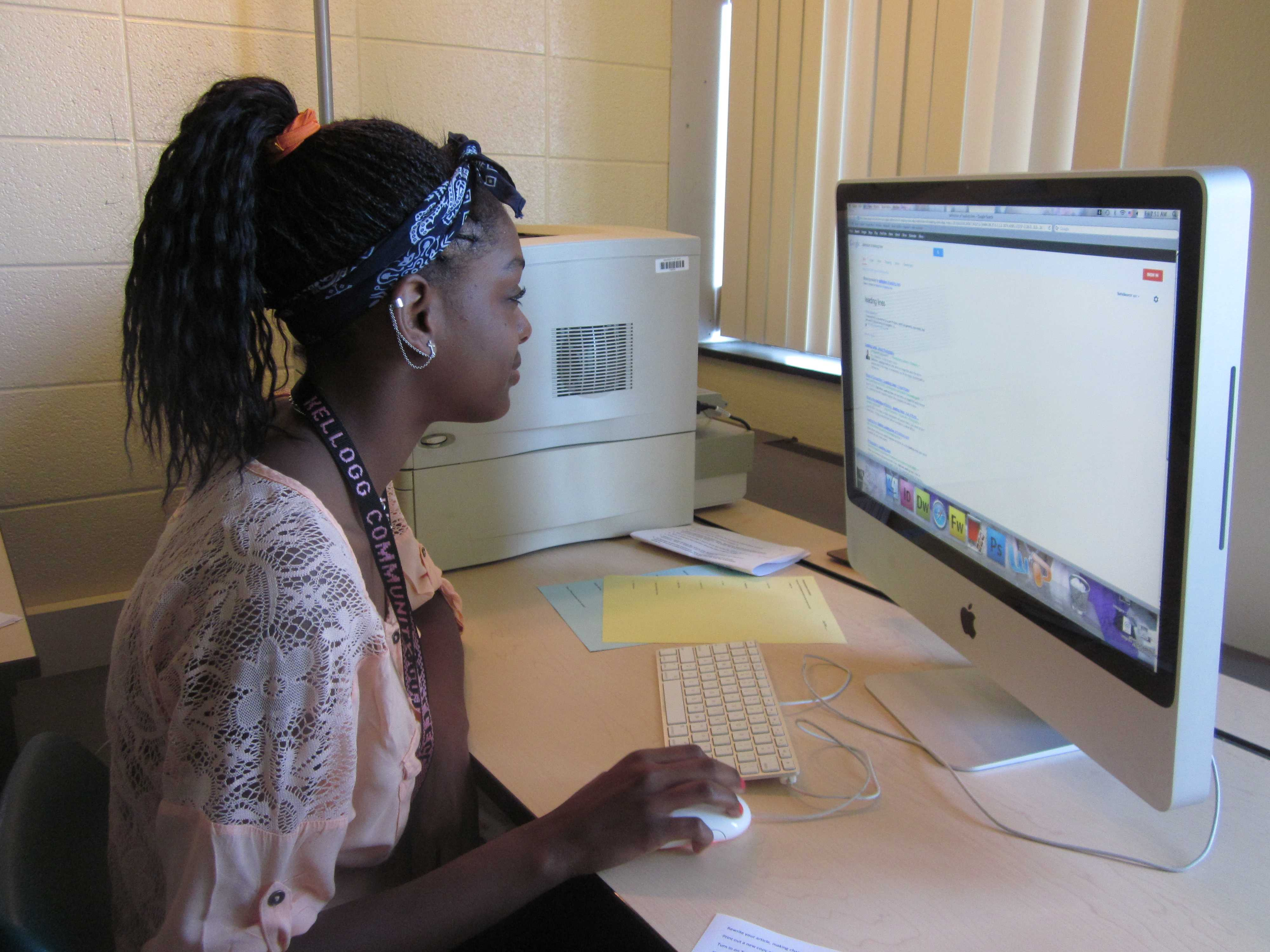 Photo by Leslie Hemenway Jazmyn Jackson is a devoted student, in addition to being a cheerleader. Here, she is looking up information in Ms. Pankop's journalism class.