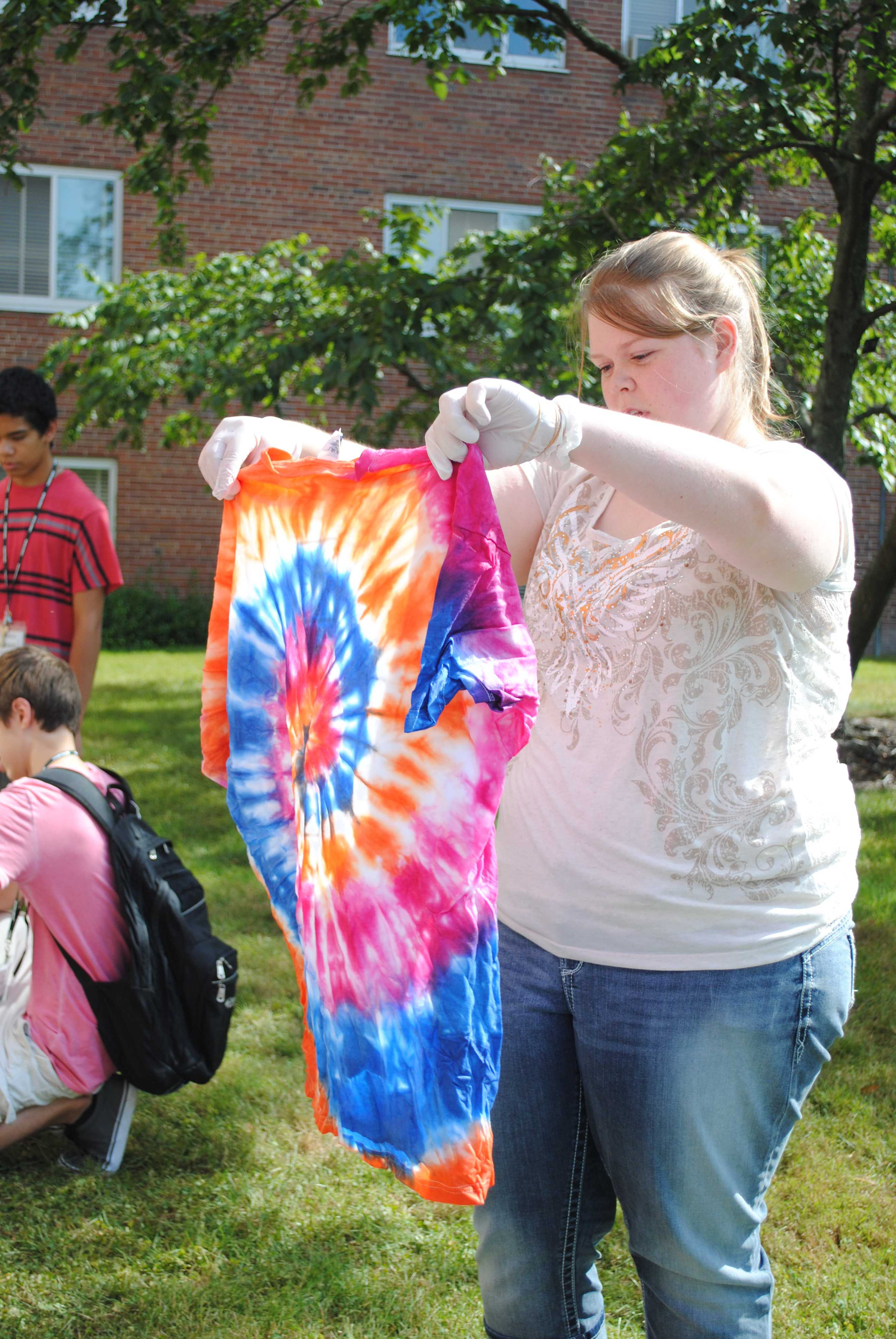 """Photo by Jordan Liddle  Sarah Stevens, a second year MIPA student was in the advanced indesign class. Stevens participated in tie-dying an official MIPA """"Learn it, Live it, Love it"""" t-shirt."""