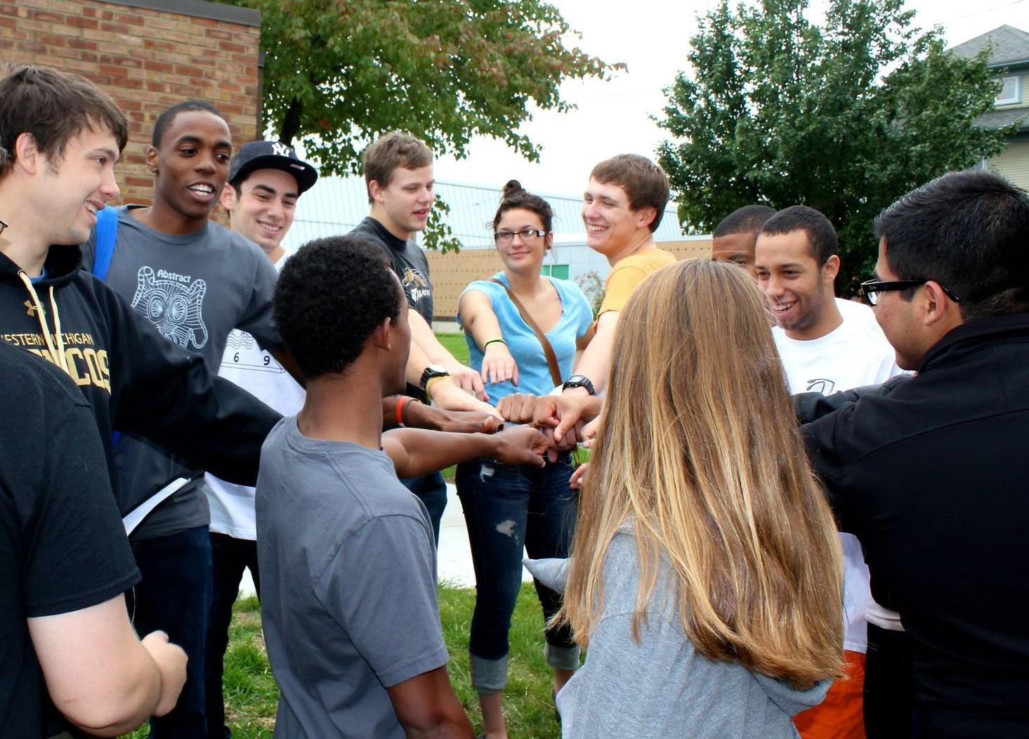 Photo credit / Allie Creamer FOCUS members Tinashe Chaponda, Ari Solomon, Chris Miller, Jazmine Ray, Brian Bartley and others get together for a team chant after the Bronson 5k Walk/Run on September 29th.