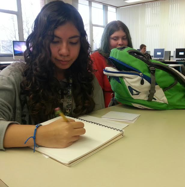 Junior Elizabeth Avila sketches a drawing a in her notebook before 4th block class. She is to drawing a christmas tree so it will be done just in time for the holidays.