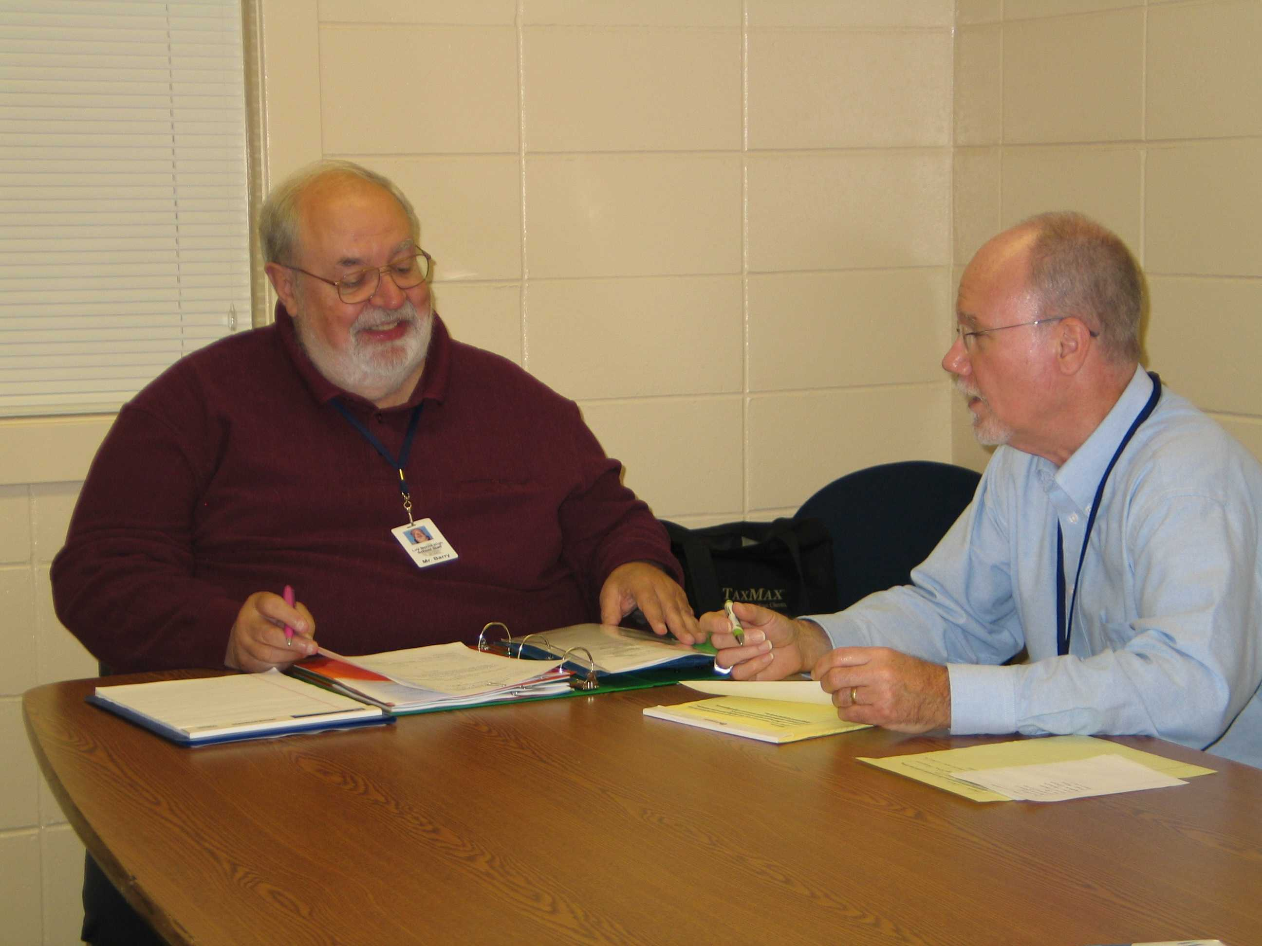 Photo Credit / Breonna Burnside  Mr. Burnside (right) and Mr. Barry (left) discuss previous mediations.