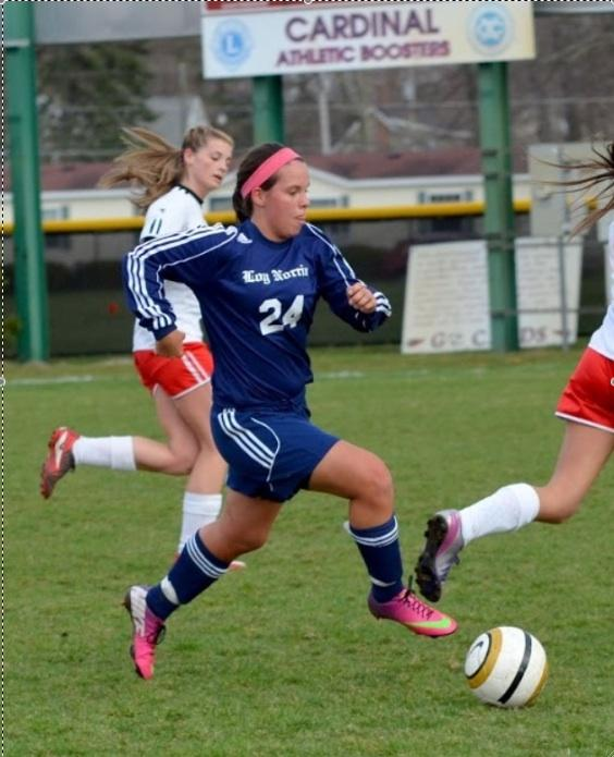 "Sophomore Julie Zabik makes her way to the opposing side in a varsity game last year. Zabik has been playing soccer for twelve years, and ""can't get enough"" of the sport. Photo by: Deanne Puca"