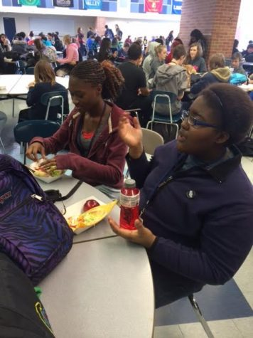 Elizabeth Gbogi sits with her friends during lunch here at Norrix, and talk about their current classes.