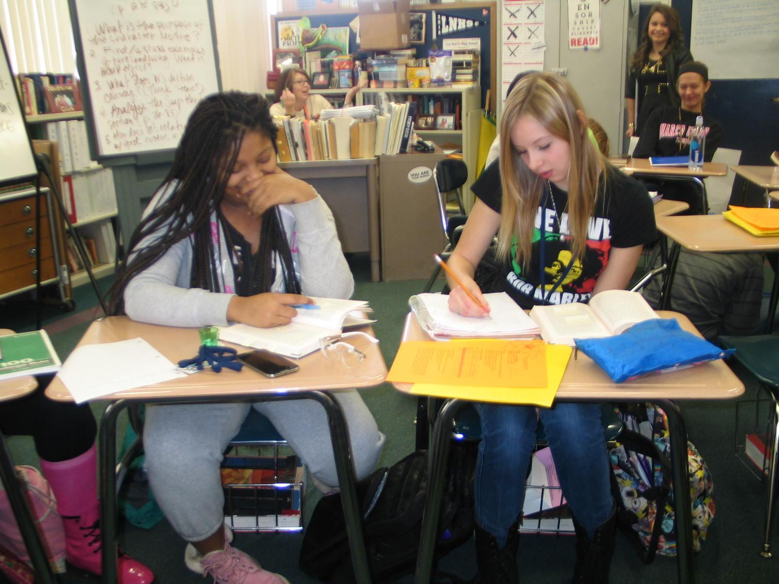 Caitlin Commissaris works hard in Ms. Lewis's class. Loy Norrix High School has a great level of diversity.