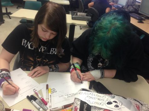 Cheyanne Walker (left) is working with Ashly Pearson (right) during Journalism. Ashly is one of the many friends who has helped Cheyanne throughout her bad times.