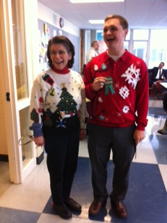 Winners of the contest are Mary Hentschl-Early on the left and Patrick Greeley on the right. Greeley said he made his Christmas sweater with his girlfriend. They bought the actual sweater at goodwill for three dollars. Greeley's girlfriend had scraps and put together a master piece. According to English teacher Tisha Pankop, she enjoyed that Hentschl-Early actually had knitted tabs to insert candy canes on her sweater.