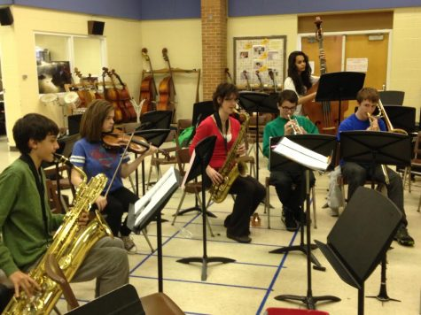Orchestra teacher and conductor, Sandra Shaw, rehearses music for the upcoming musical,