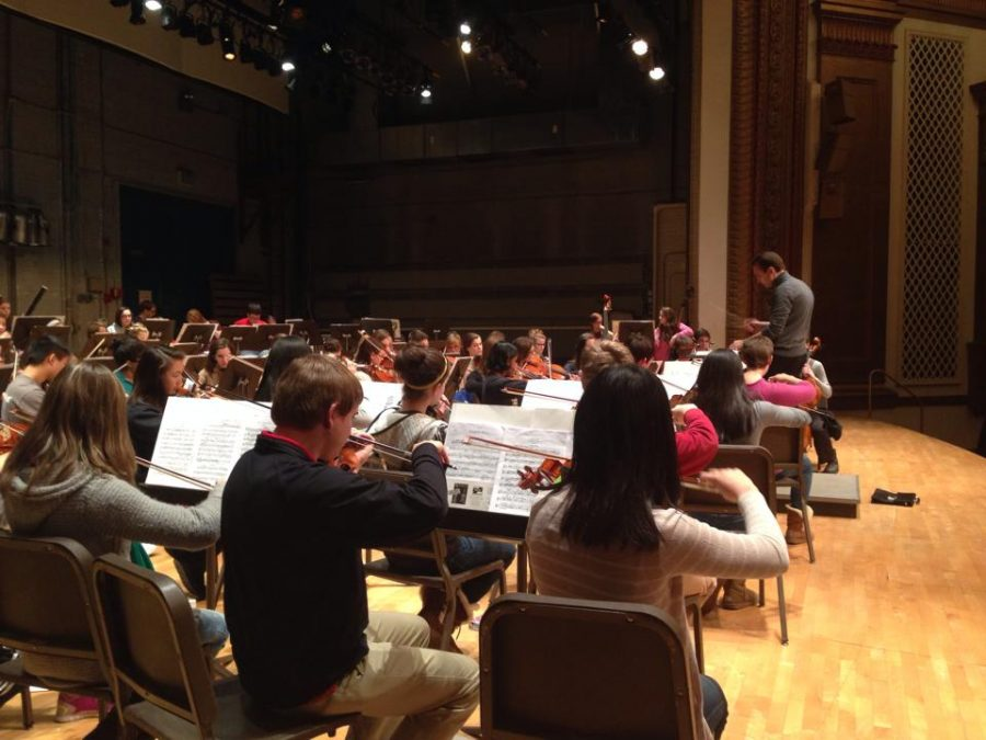 Conductor Andrew Koehler prepares the KJSO for practicing with Midori. Midori played with the KJSO on February 2.