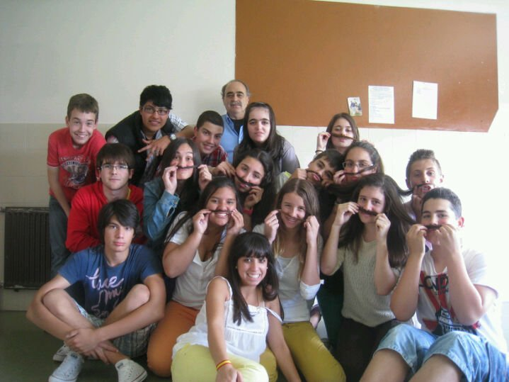 In this picture you can see some students and the Physics teacher of one of my classes in my high school Monte das Moas in Spain, two years ago. These was the last day of school and they are making a joke, putting mustaches on their faces, honoring the Physics teacher.