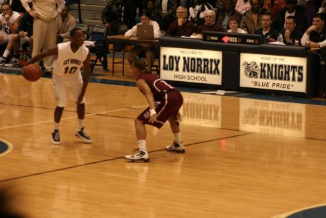 Loy Norrix basketball alumni Jeff Hoskins looks to push the team to a victory vs. Kalamazoo Central. Hoskins is now a basketaball player on Indiana Tech.