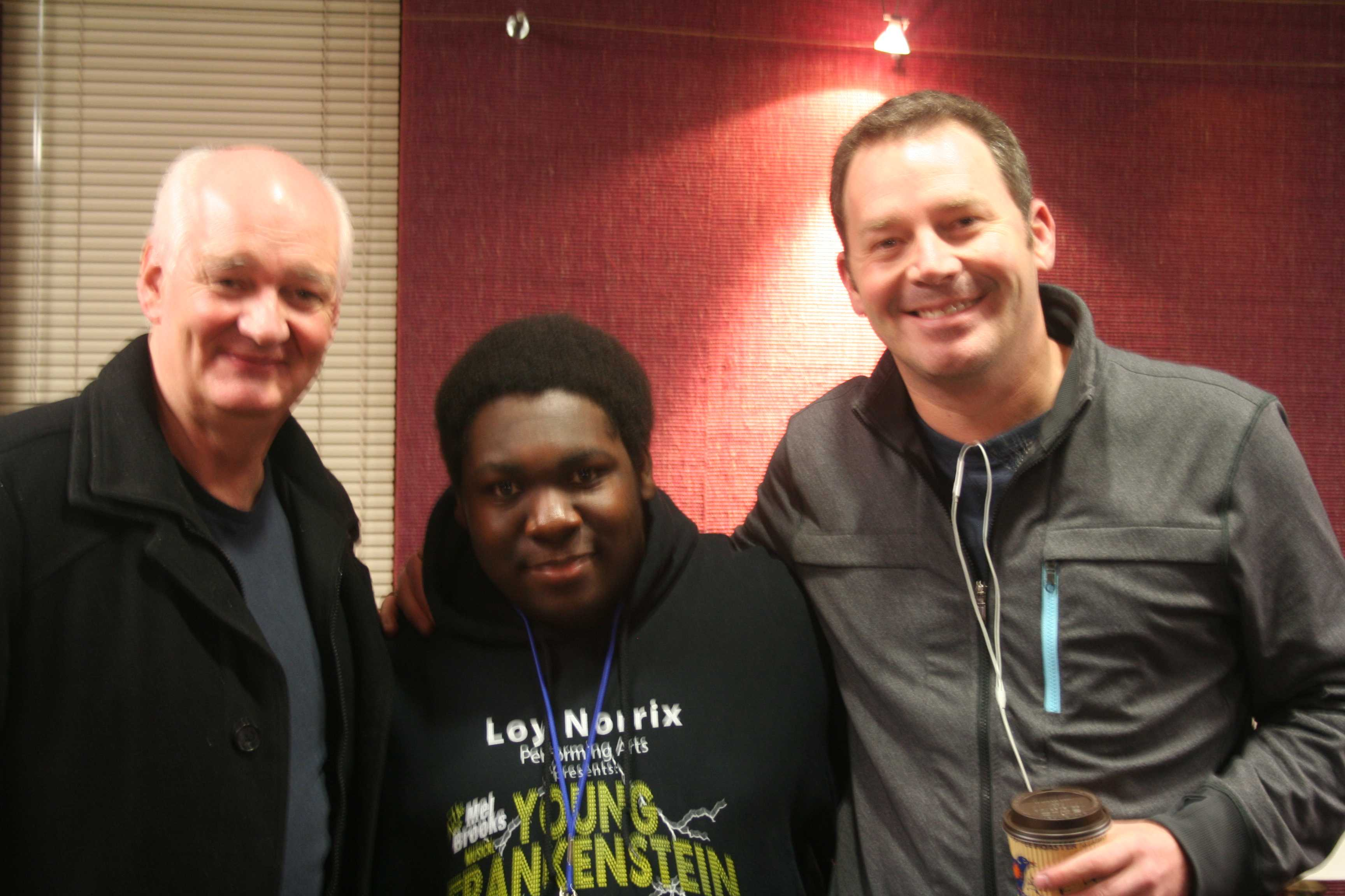 Here we see Loy Norrix sophomore between Colin Mocherie (left) and Brad Sherwood (right), in the Greenroom of Miller Auditorium before their two man improv show.