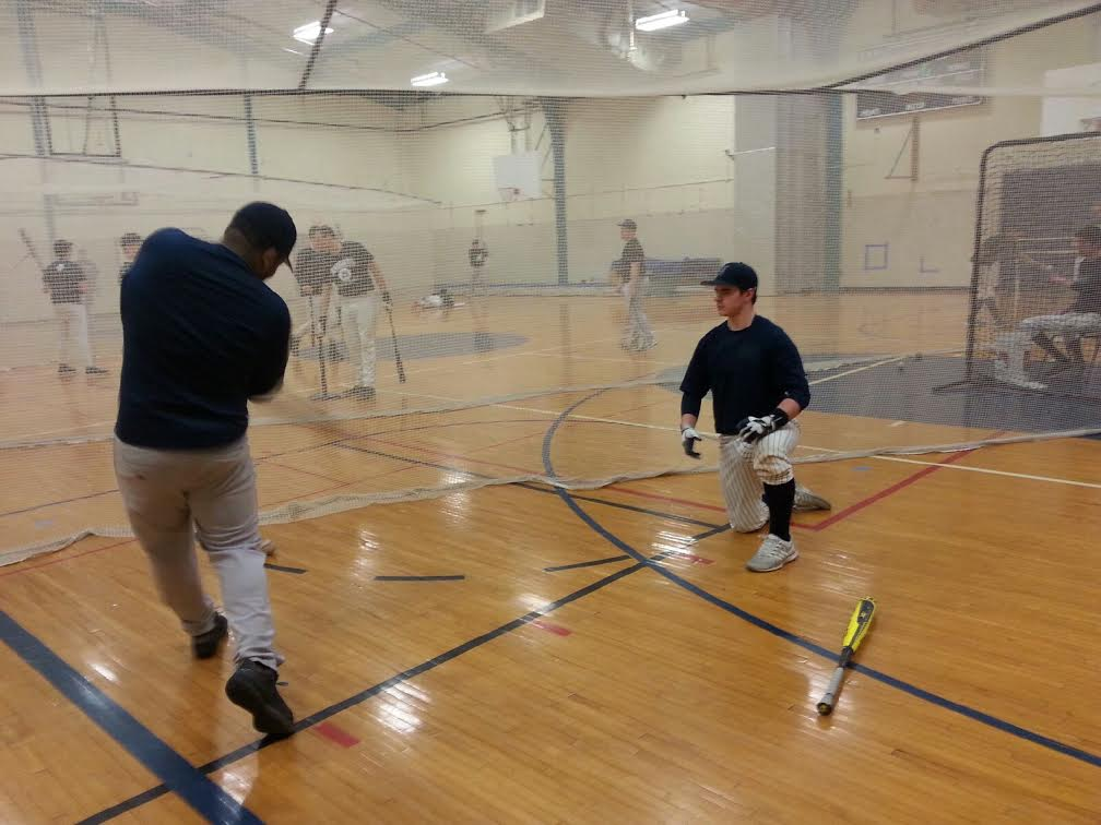 Senior Jared Graves and Junior Austin Thompson practice batting. Graves plays first base and Thompson plays shortstop.