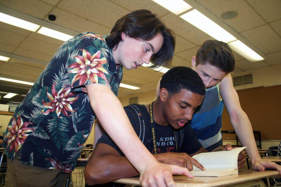 From left: Aaron Eshleman, Jerrell Lipsey, and Jacob Atkins prepare for their final exams to close out their junior year. The rising seniors look forward to another year while anxiously awaiting the future.