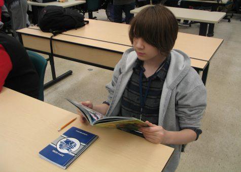 Freshman Bela Coats focused on reading the comic book